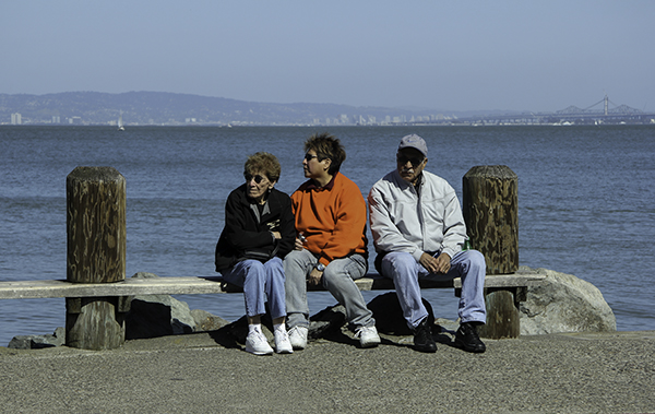 three people on a bench