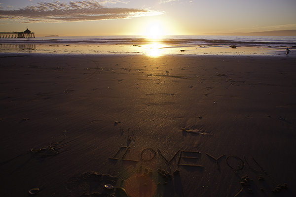 carving love in the sand