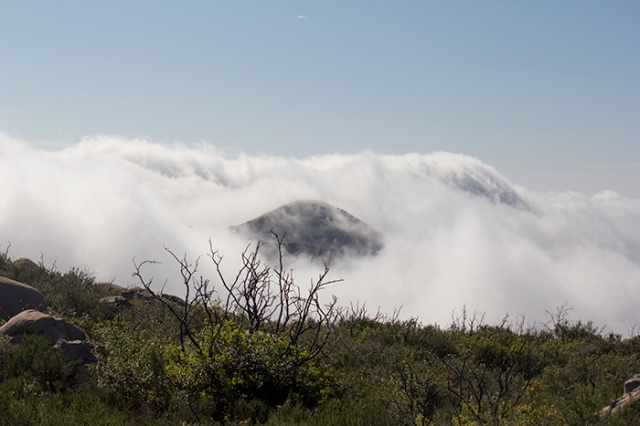 a clouded peek at a mountain peak