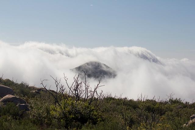 a clouded peek at a mountain peak
