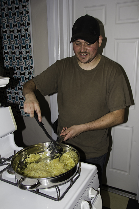 Mike stirring the onions
