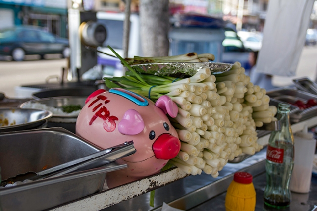 tip jar and fried onions on a street cart
