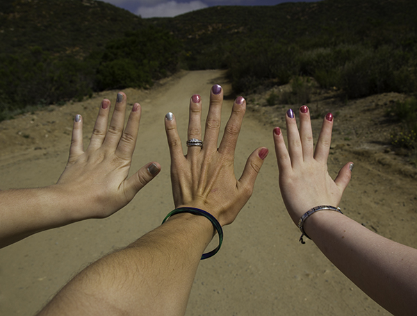 hiking hands with color changing nail polish