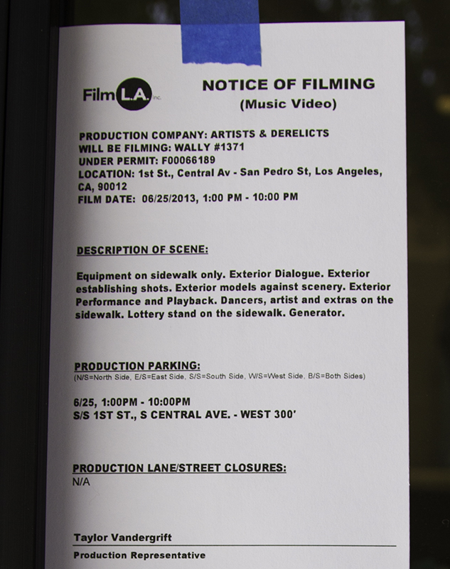 notice of filming posted on a business's door