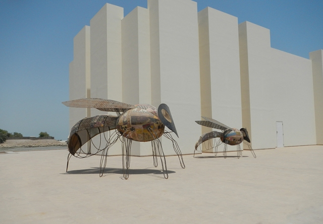 flies in front of Qal' at al-Bahrain Museum