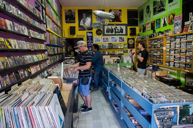 Jonas looking at vinyl records