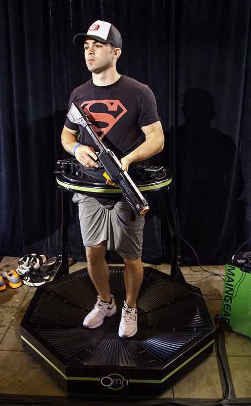 Superman on an Omni with an Oculus Rift within reach
