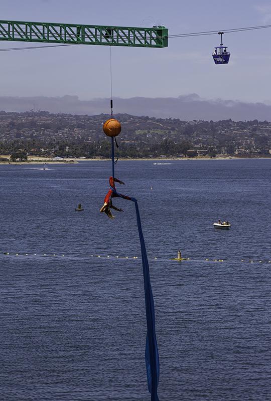 aerial gymnast on fabric at Cirque de la Mer