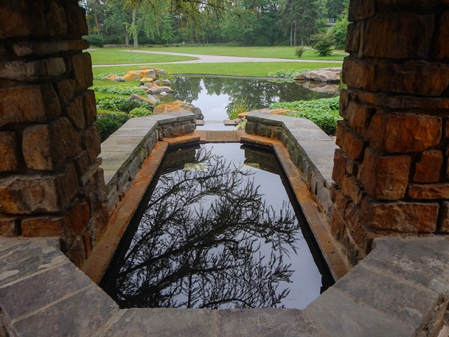 reflective pool at Graycliff Estate - by Caleb