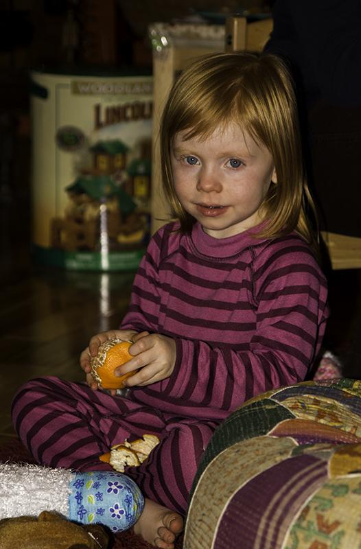 Emma eating a mandarin