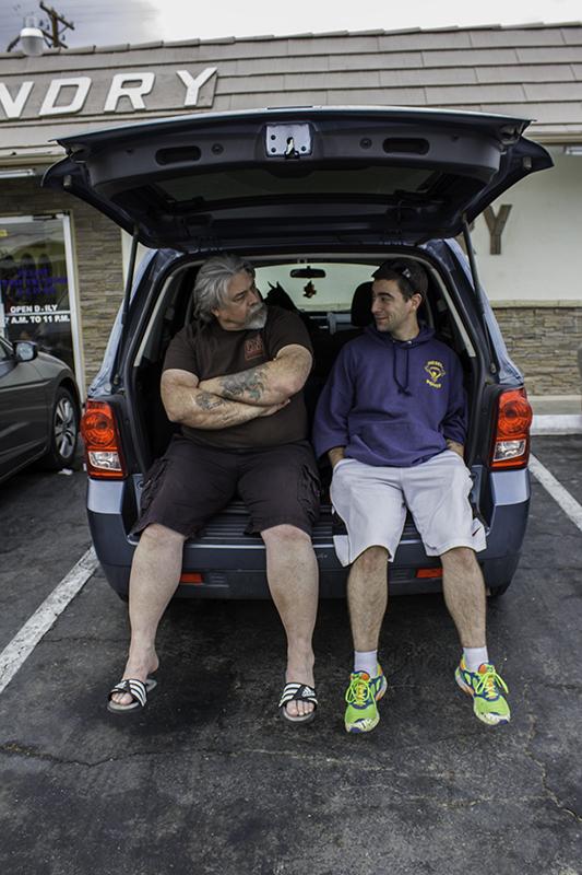 Ed and Caleb waiting on laundry