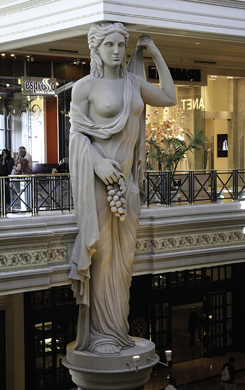 tall woman watching over the Forum Shops