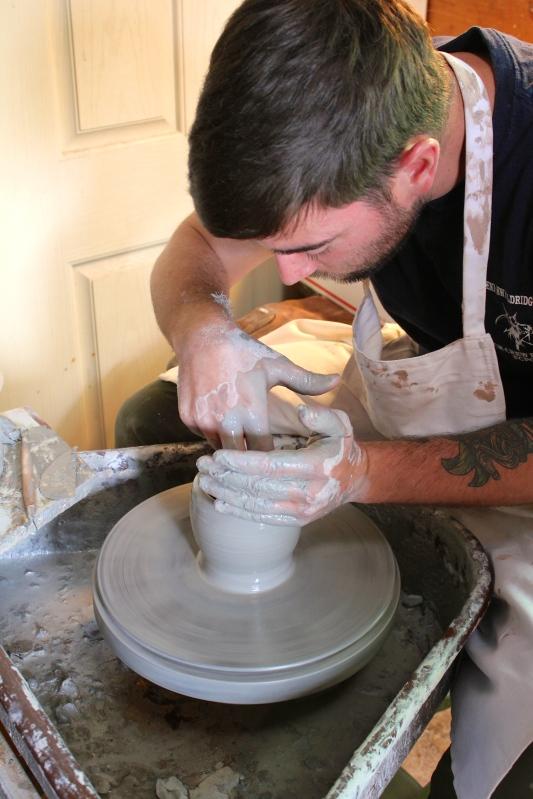 Caleb making a cup