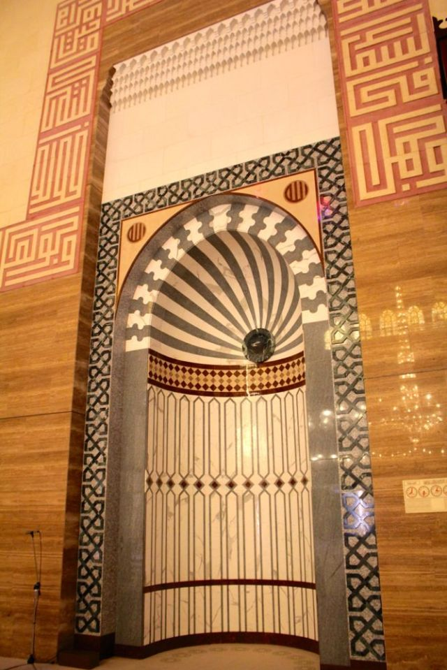 a mihrab that marks the direction of the qiblah (Mecca)