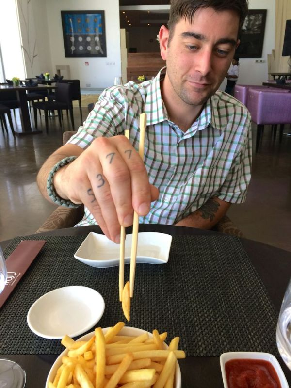 eating French fries with chopsticks