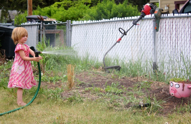 Lyra watering the garden