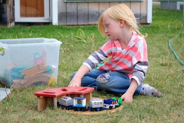 Sammi playing with trains