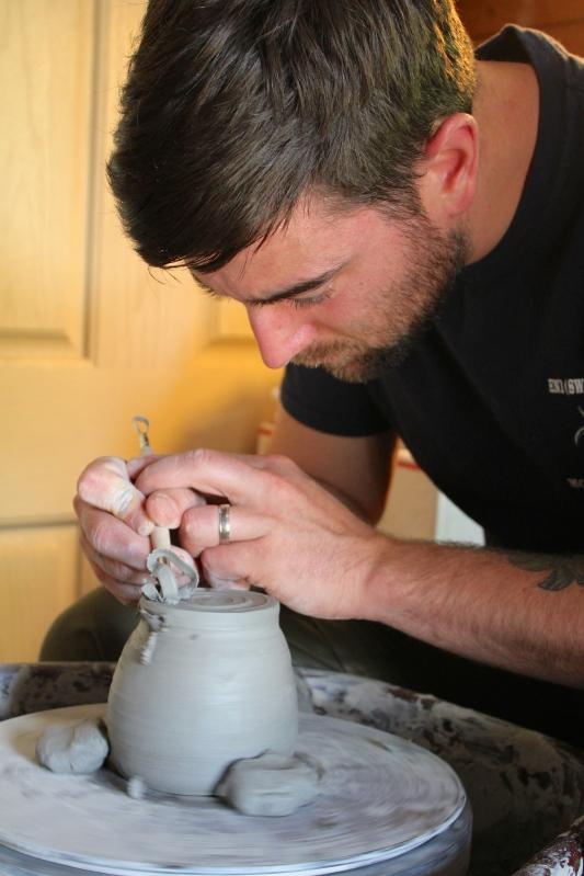 Caleb scraping his cup