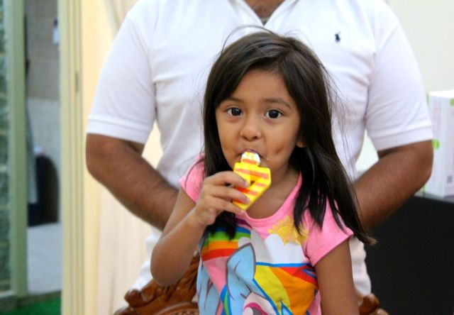 Angel enjoying the icing, Sabi behind her