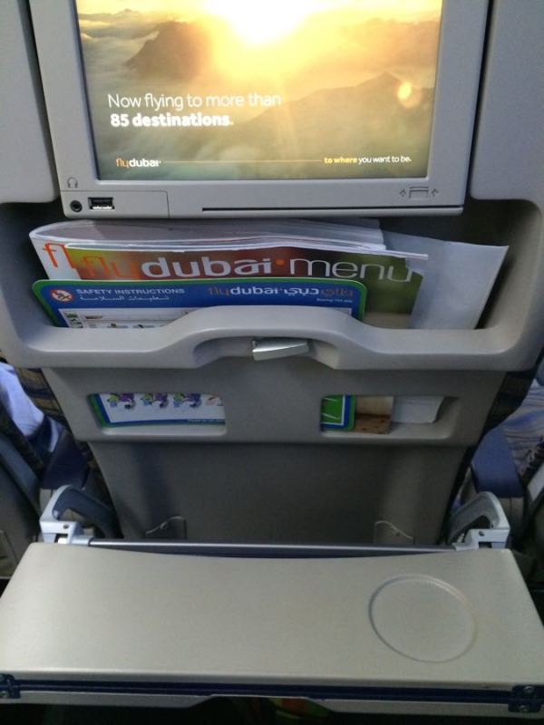 a menu (no free water or snacks) and a folding tray - less leg room and more tummy space