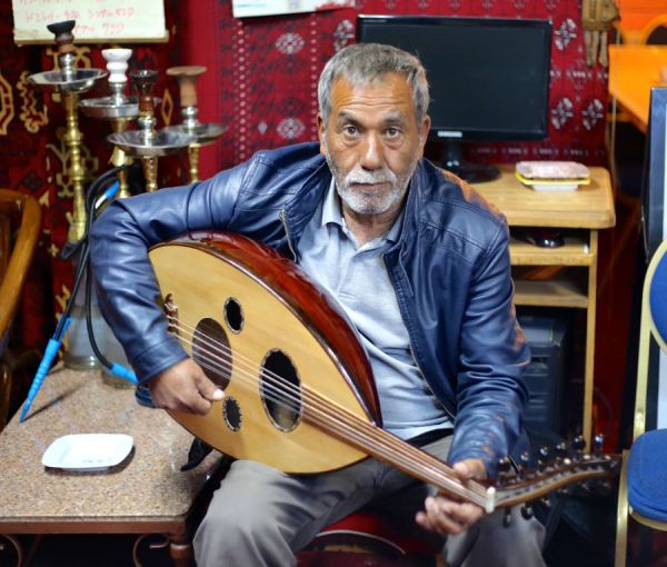 old man with his oud