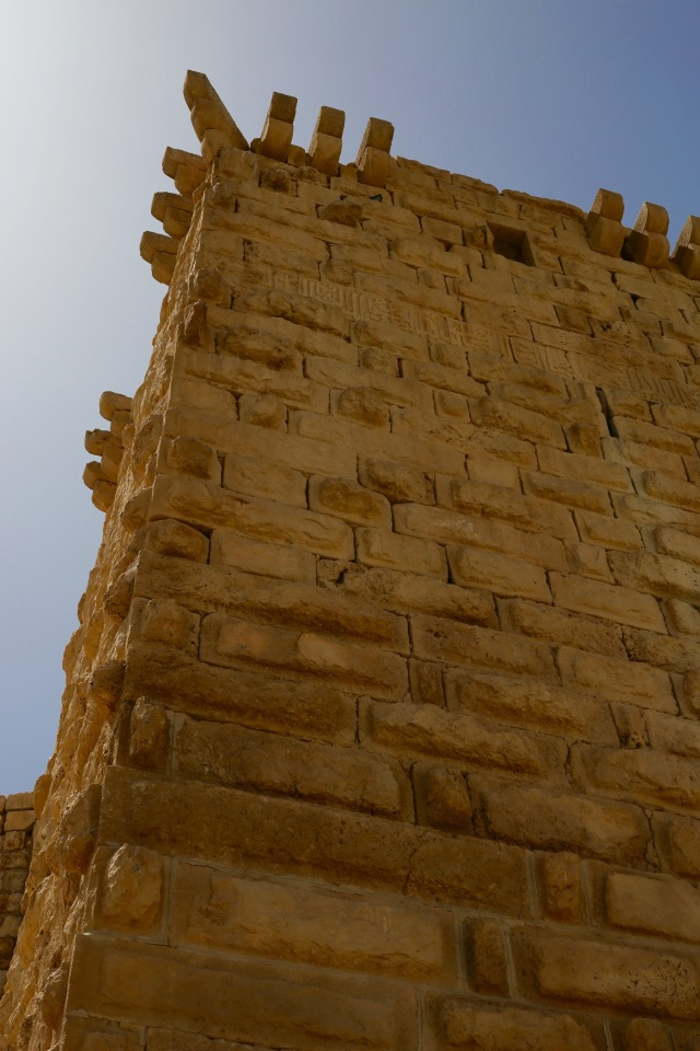 tower with stone inscription