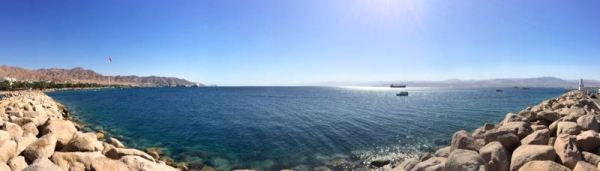 panorama of Aqaba beach with Saudi, Egypt, and Israel in the distance