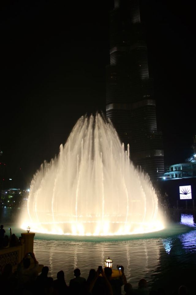 fountain and reflection in front of Burj Khalifa